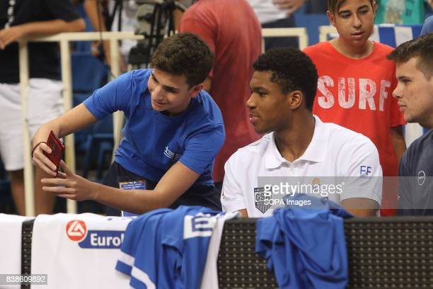 Greece's fan taking selfie photos with Yiannis Antetokounmpo at the Acropolis basketball tournament at the indoor Olympic stadium of Athens Georgia...