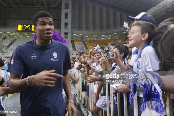 Greece's fan taking selfie photos with Yiannis Antetokounmpo at the Acropolis basketball tournament at the indoor Olympic stadium Georgia beats...