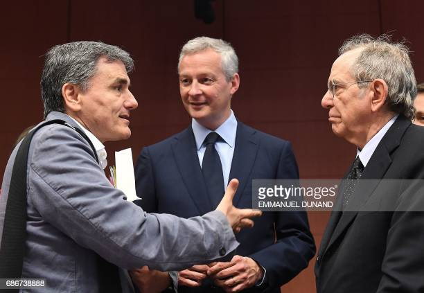 Greece's Finance Minister Euclid Tsakalotos France's Economy Minister Bruno Le Maire and Italy's Finance Minister Pier Carlo Padoan speak to one...
