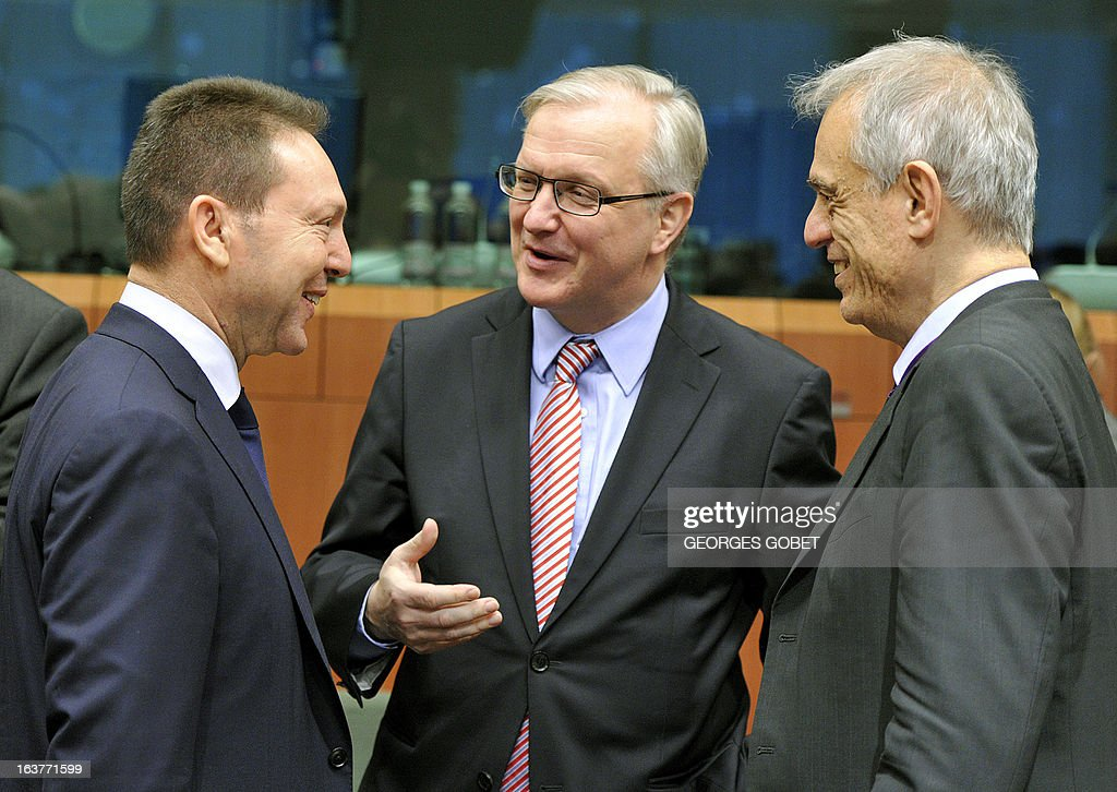 Greece's Finance Minister Ioannis Stournaras, EU Commissioner for Economic and Monetary Affairs Olli Rehn and Cyprus' Finance Minister Michael Sarris talk on March 15, 2013 prior to attend a Eurozone meeting at the EU Headquarters in Brussels. Finance ministers of the euro zone were expected late March 15 afternoon to try to complete the plan of aid to Cyprus, wishing to obtain the eurozone and the IMF loan of 17 billion euros the equivalent of the gross domestic product.