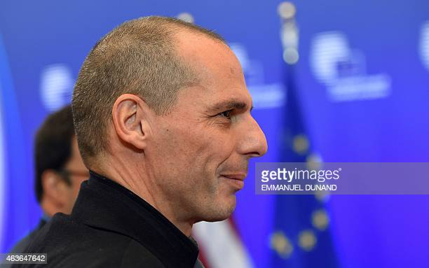 Greece's Finance Minister Yanis Varoufakis arrives to take part in a European economic and financial affairs meeting at the European Council in...