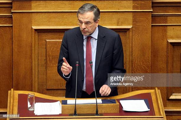 Greece's former Prime Minister Antonis Samaras speaks during a parliament session before the confidence vote of the new government in Athens Greece...