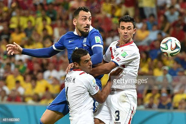 Greece's forward Konstantinos Mitroglou vies with Costa Rica's defenders Giancarlo Gonzalez and Michael Umana during a Round of 16 football match...