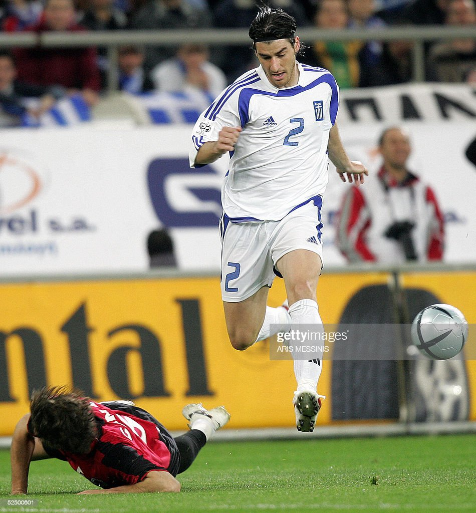 Greece's George Seitaridis vies for the ball with Albania's Loric Cana during their 2006 World Cup qualification football game in Athens 30 March...