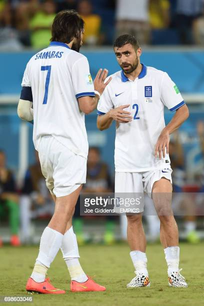Greece's Georgios Samaras speaks to teammate Ioannis Maniatis