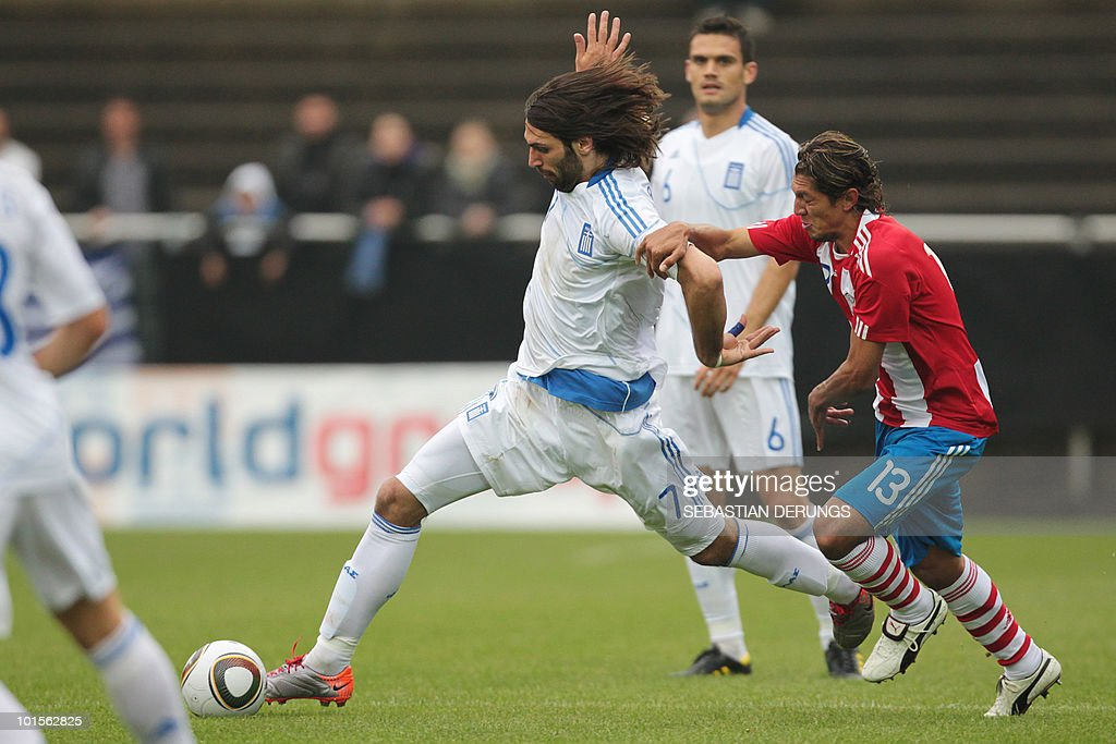 Greece's Georgios Samaras (L) vies for the ball with Paraguay's Enrique Vera during a friendly football game in Winterthur on June 2, 2010 ahead of their participation to the FIFA World Cup 2010 in South Africa.