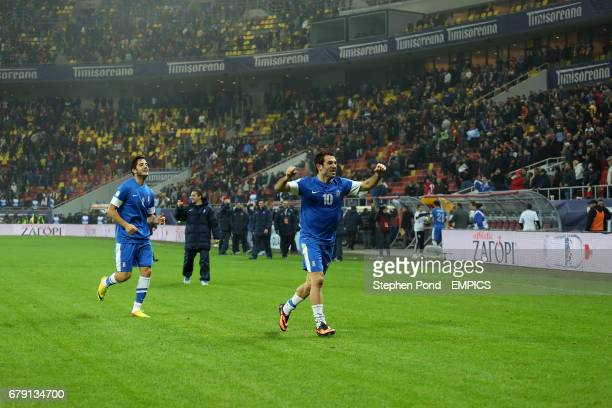 Greece's Giorgos Karagounis and Kostas Manolas celebrate at the final whistle