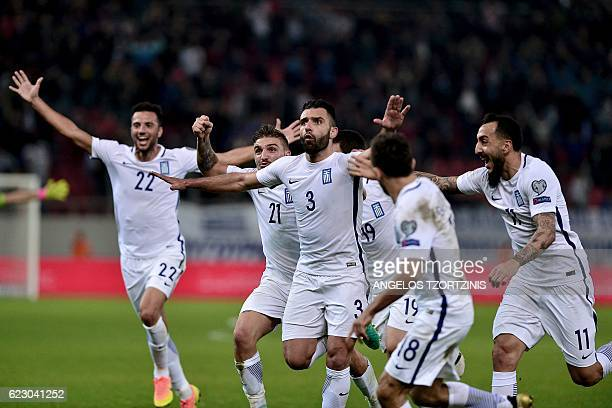 Greece's Giorgos Tzavellas celebrates after scoring a goal during the 2018 World Cup football qualification match between Greece and Bosnia and...