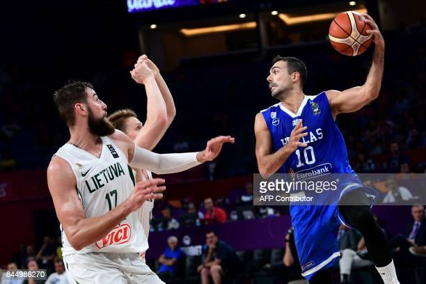Greece's guard Kostas Sloukas vies for the ball with Lithuania's center Jonas Valanciunas during the FIBA Eurobasket 2017 men's round 16 basketball...