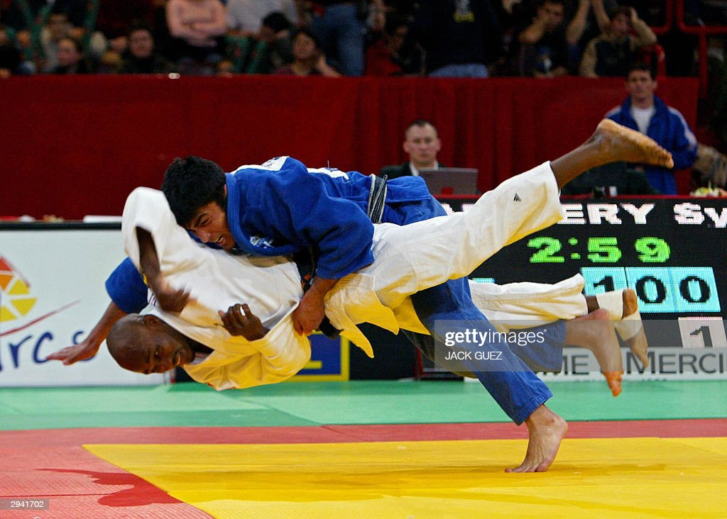 Greece's Ilias Iliadis fights against France's Dylvio Adigery during their under 81 kg bout of the 30th Paris Judo tournament 07 February 2004 at the...