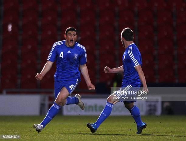Greece's Kiriakos Papadopoulos celebrates scoring his sides first goal of the game with teammate Giannis Skondras