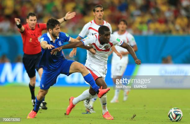 Greece's Konstantinos Manolas and Costa Rica's Joel Campbell battle for the ball