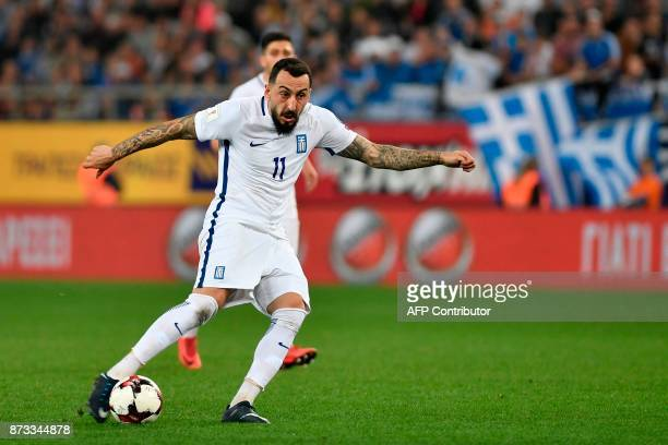 Greece's Konstantinos Mitroglou controls the ball during the World Cup 2018 playoff football match Greece vs Croatia on November 12 2017 in Piraeus /...