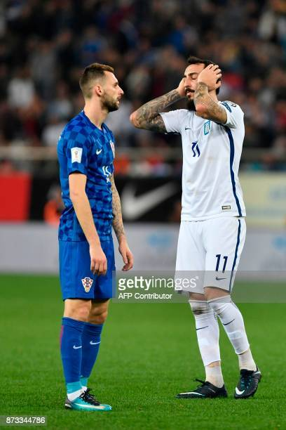 Greece's Konstantinos Mitroglou reacts during the World Cup 2018 playoff football match Greece vs Croatia on November 12 2017 in Piraeus / AFP PHOTO...