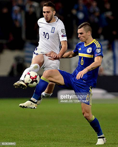 Greece's Kostas Fortounis vies for the ball with Bosnia and Herzegovina's Ognjen Vranjes during the 2018 World Cup football qualification match...