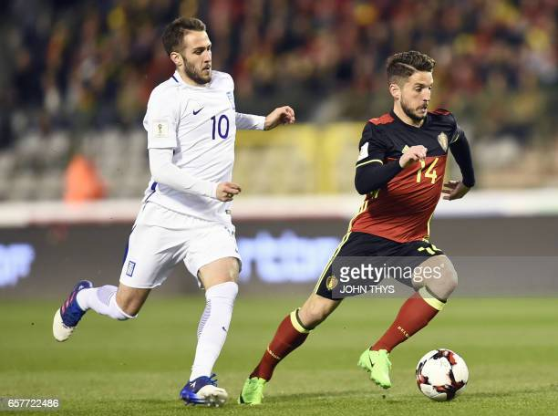 Greece's Kostas Fortounis vies with Belgium's forward Dries Mertens during the FIFA World Cup 2018 qualifying football match between Belgium and...