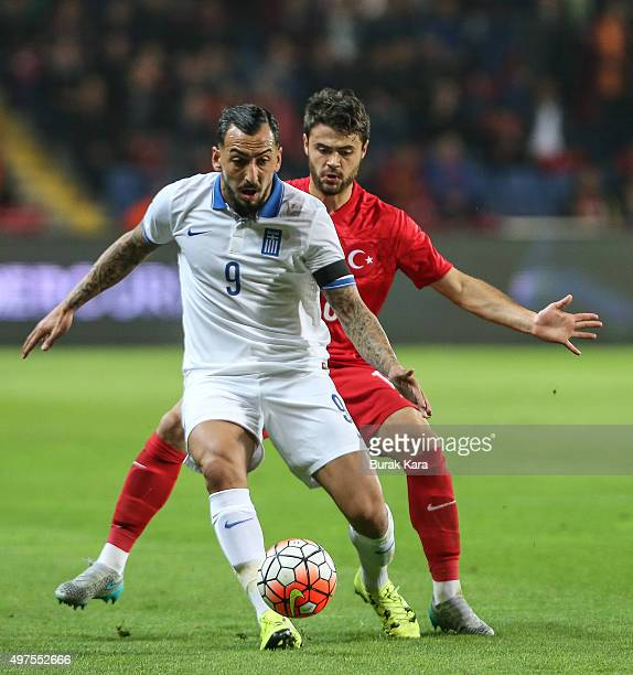 Greece's Kostas Mitroglou is in action with Turkey's Ahmet Yilmaz Calik during an international friendly soccer match between Greece and Turkey...