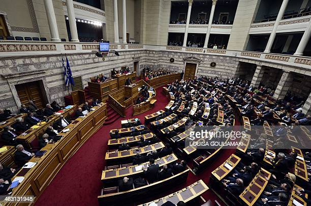 Greece's main opposition party leader Antonis Samaras speaks during a parliament session ahead of the confidence vote of the new government on...
