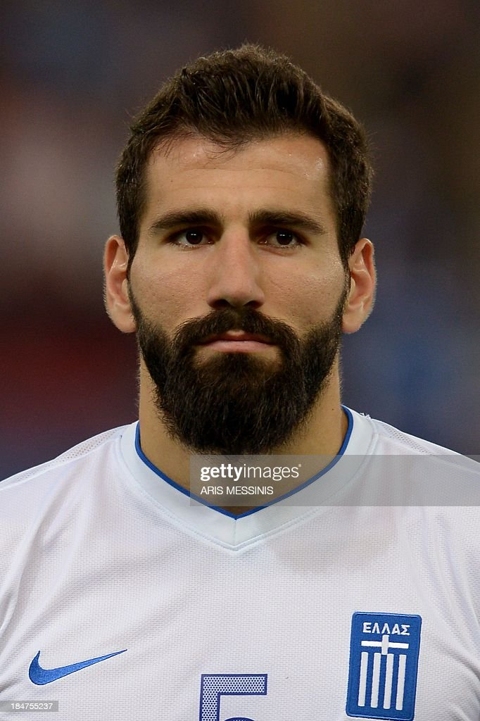 Greece's national football defender Dimitris Siovas poses prior to the 2014 World Cup qualifying football match Greece vs Liechtenstein at the Karaiskaki stadium in Athens on October 15, 2013. AFP PHOTO / Aris Messinis