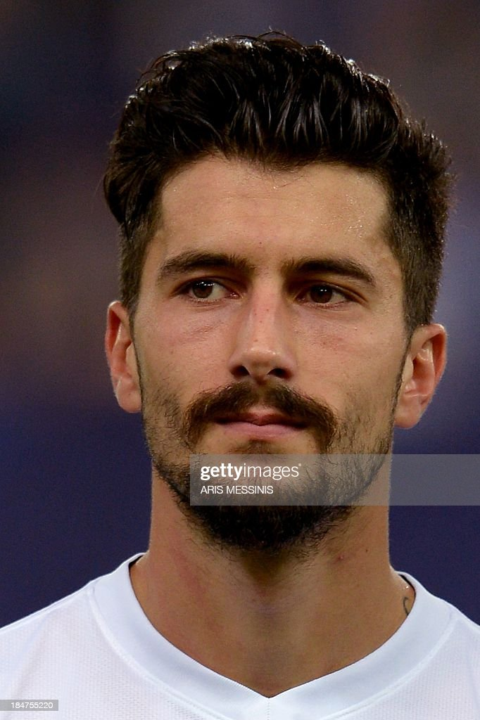 Greece's national football midfielder Panagiotis Kone poses prior to the 2014 World Cup qualifying football match Greece vs Liechtenstein at the Karaiskaki stadium in Athens on October 15, 2013. AFP PHOTO / Aris Messinis