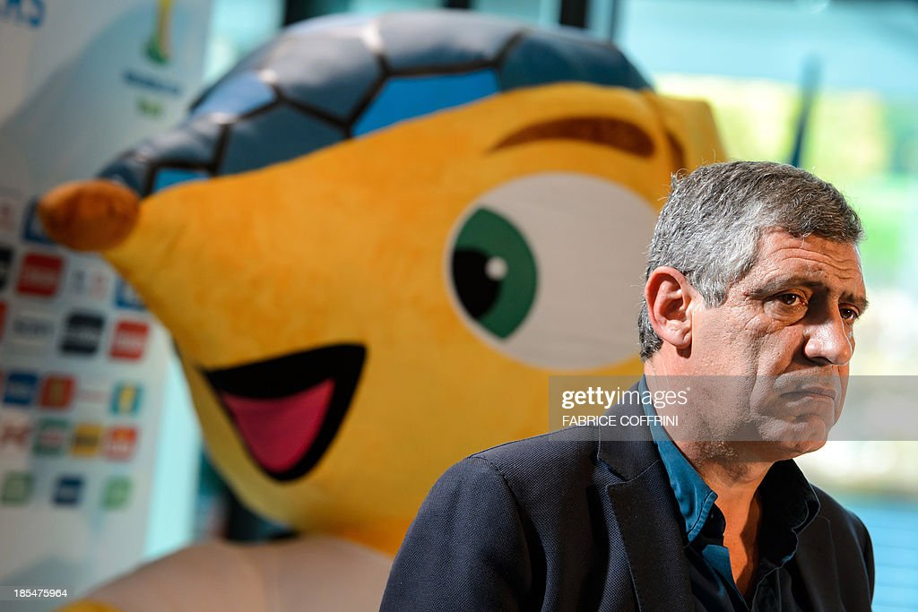 Greece's national football team coach Portugese Fernando Santos answers journalists' questions on October 21, 2013 next to the mascot of the FIFA World Cup 2014 after attending the draw for the 2014 FIFA World Cup European zone play-off matches held at the headquarters of the football's world governing body in Zurich. The play-off matches are due to be played on November 15 and 19.