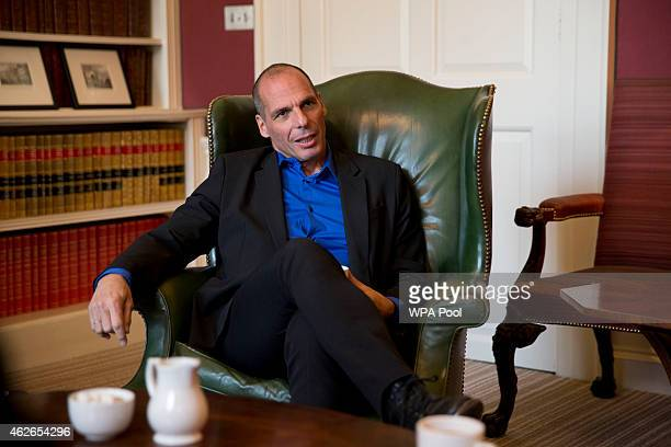 Greece's new finance minister Yanis Varoufakis speaks to British Chancellor Of The Exchequer George Osborne during their meeting at 11 Downing Street...
