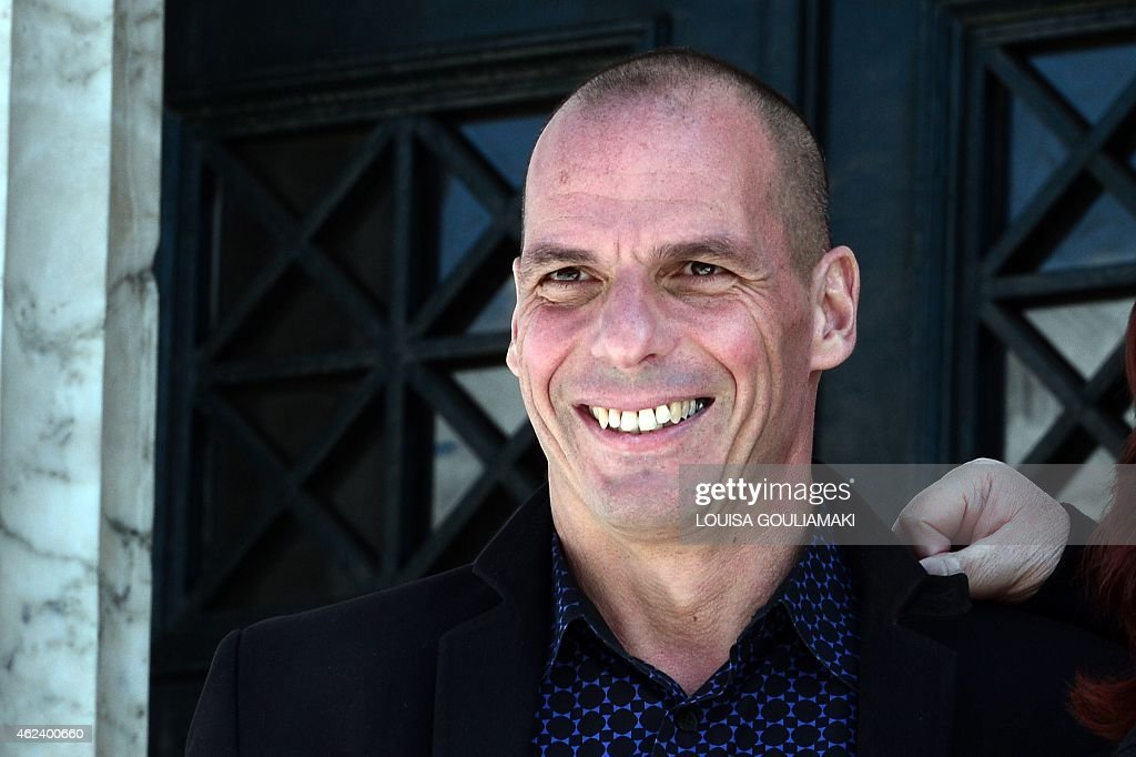 Greece's newly appointed Finance Minister Yianis Varoufakis smiles on January 28 2015 outside the Greek Parliament in Athens Greece's new radical...