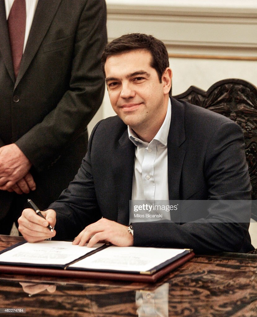 Greece's newly appointed Prime Minister <a gi-track='captionPersonalityLinkClicked' href=/galleries/search?phrase=Alexis+Tsipras&family=editorial&specificpeople=6592450 ng-click='$event.stopPropagation()'>Alexis Tsipras</a> poses after taking a secular oath at the Presidential Palace on January 26, 2015 in Athens, Greece. <a gi-track='captionPersonalityLinkClicked' href=/galleries/search?phrase=Alexis+Tsipras&family=editorial&specificpeople=6592450 ng-click='$event.stopPropagation()'>Alexis Tsipras</a> was sworn in with a secular oath, rather than the traditional Greek Orthodox ceremony, becoming the youngest man to hold the post of Prime Minister in 150 years. The radical left party Syriza won the snap Greek general election and has asked the right-wing Independent Greek party to form a anti-austerity coalition.