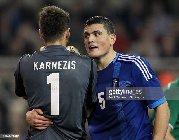 Greece's Orestis Karnezis and Kyriakos Papadopoulos