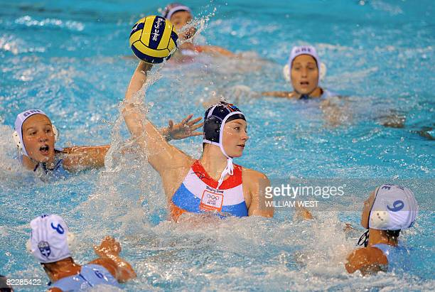 Greece's players surround Netherlands' Lefke van Belkum as she attempts to score during their women's preliminary round group B water polo match at...