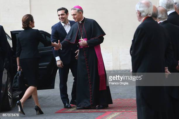 Greece's Prime Minister Alexis Tsipras and his wife Betty Batziana are welcomed by the prefect of the papal household Georg Gaenswein as they arrive...