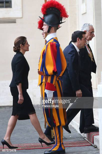 Greece's Prime Minister Alexis Tsipras and his wife Betty Batziana arrive at the Apostolic Palace for an audience of Pope Francis with 27 heads of...