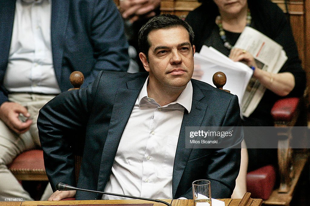 Greece's Prime Minister <a gi-track='captionPersonalityLinkClicked' href=/galleries/search?phrase=Alexis+Tsipras&family=editorial&specificpeople=6592450 ng-click='$event.stopPropagation()'>Alexis Tsipras</a> attends an emergency Parliament session for the government's proposed referendum June 27, 2015 in Athens, Greece. Greece's fraught bailout talks with its creditors took a dramatic turn early Saturday, with the radical left government announcing a referendum in just over a week on the latest proposed deal .