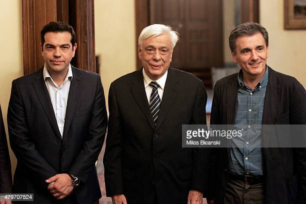 Greece's Prime Minister Alexis Tsipras Greek President Prokopis Pavlopoulos and the new Greek Finance Minister Euclid Tsakalotos pose for the...