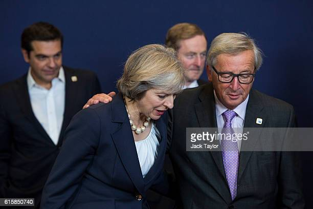 Greece's Prime minister Alexis Tsipras Ireland's and Prime minister Enda Kenny look on as British Prime Minister Theresa May talks with President of...