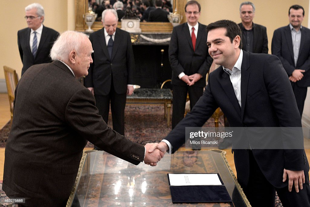 Greece's Prime Minister Alexis Tsipras is sworn in with Greek President Karolos Papoulias at the Presidential Palaceon January 26, 2015 in Athens, Greece. Alexis Tsipras was sworn in with a secular oath, rather than the traditional Greek Orthodox ceremony, becoming the youngest man to hold the post of Prime Minister in 150 years. The radical left party Syriza won the snap Greek general election and has asked the right-wing Independent Greek party to form a anti-austerity coalition.