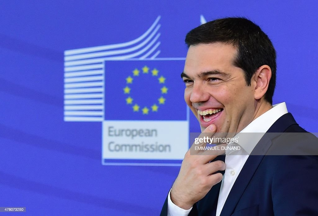 Greece's Prime Minister <a gi-track='captionPersonalityLinkClicked' href=/galleries/search?phrase=Alexis+Tsipras&family=editorial&specificpeople=6592450 ng-click='$event.stopPropagation()'>Alexis Tsipras</a> laughs as he welcomed by the European Commission president ahead of an emergency summit with the leaders of Athens' creditors at the European Commission in Brussels, on June 22, 2015. The European Central Bank (ECB) again increased emergency liquidity funds for Greece's banks on June 22, according to a Greek bank source who said the ECB may renew the hike 'at any time' if necessary. AFP PHOTO / EMMANUEL DUNAND