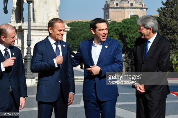Greece's Prime Minister Alexis Tsipras reacts as Malta's Prime minister Joseph Muscat European Council President Donald Tusk and Italy's Prime...