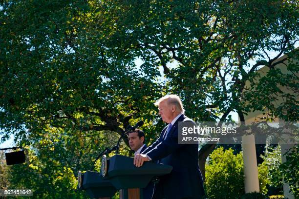 Greece's Prime Minister Alexis Tsipras talks during a joint press conference with US President Donald Trump in the Rose Garden of the White House in...
