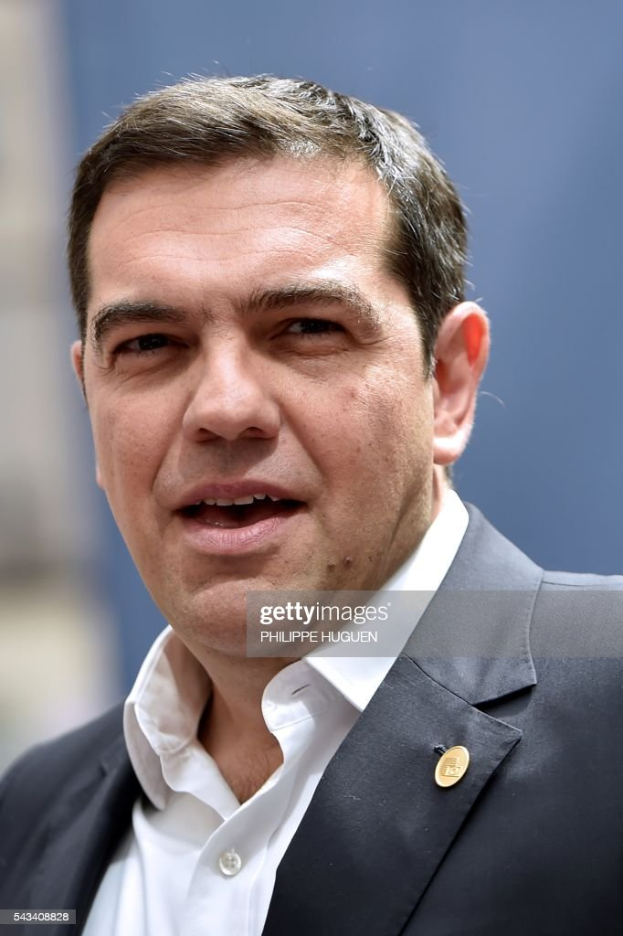 Greece's Prime minister Alexis Tsipras talks to the press as he arrives before an EU summit meeting on June 28, 2016 at the European Union headquarters in Brussels. / AFP / PHILIPPE