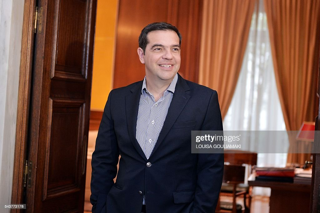 Greece's Prime Minister Alexis Tsipras waits for Germany's vice chancellor and economy minister prior their meeting in Athens on June 30, 2016. / AFP / LOUISA