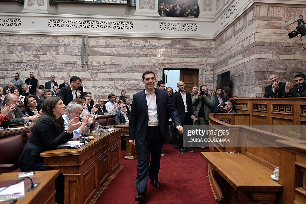 Greece's Prime Minister Alexis Tsipras walks towards the stage to address MPs at the Greek parliament in Athens on February 5 2015 as Greece's...