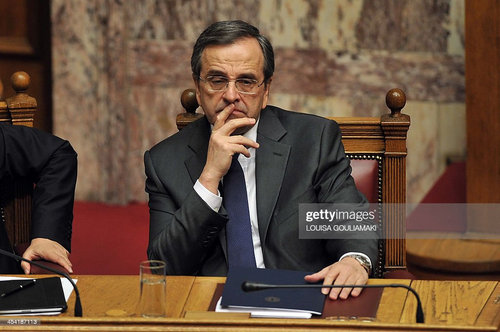 Greece's Prime Minister Antonis Samaras looks on prior to his speech during a parliamentary session before voting on the 2014 budget in Athens on December 7, 2013. Greece's parliament prepared to approve next year's budget, which forecasts an end to the recession that has gripped the country since 2008.