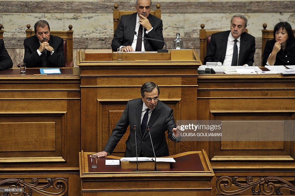Greece's Prime Minister Antonis Samaras speaks at a parliamentary session before voting on the 2014 budget in Athens on December 7, 2013. Greece's parliament prepared to approve next year's budget, which forecasts an end to the recession that has gripped the country since 2008.
