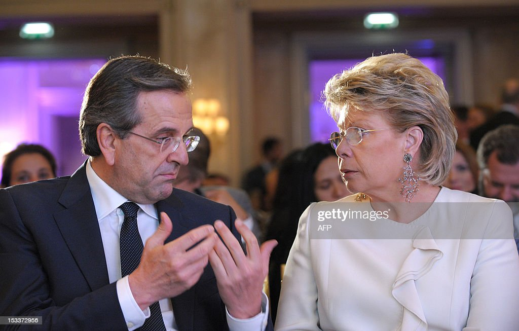 Greece's Prime Minister Antonis Samaras talks with Viviane Reding, European Commission Vice-President and Commissioner for Justice, Fundamental Rights and Citizenship prior to his keynote address as part of the International Herald Tribune Global Conversation in Paris on October 4, 2012.