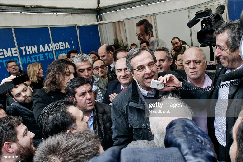 Greece's Prime Minister <a gi-track='captionPersonalityLinkClicked' href=/galleries/search?phrase=Antonis+Samaras&family=editorial&specificpeople=970799 ng-click='$event.stopPropagation()'>Antonis Samaras</a> with his supporters outside an election kiosk of his conservative New Democracy party on January 24, 2015 in Athens, Greece. Greece goes to the polls Sunday in a snap general election that has thrown into question whether the country will abide by the terms of its international bailout agreement if the left-wing Syriza comes to power.