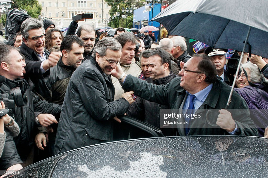 Greece's Prime Minister Antonis Samaras with his supporters outside an election kiosk of his conservative New Democracy party on January 24, 2015 in Athens, Greece. Greece goes to the polls Sunday in a snap general election that has thrown into question whether the country will abide by the terms of its international bailout agreement if the left-wing Syriza comes to power.