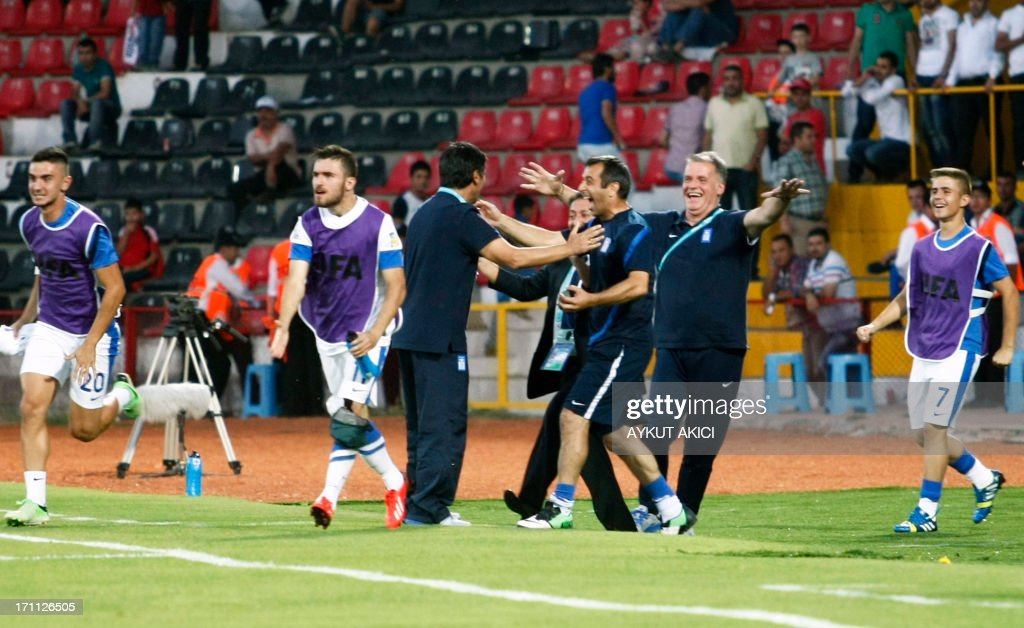 Greece's staff and players celebrate scoring a goal during the group stage football match between Mexico and Greece at the FIFA Under 20 World Cup at the Kamil Ocak stadium in Gaziantep on June 22, 2013. AFP PHOTO/TURKPIX/Aykut AKICI