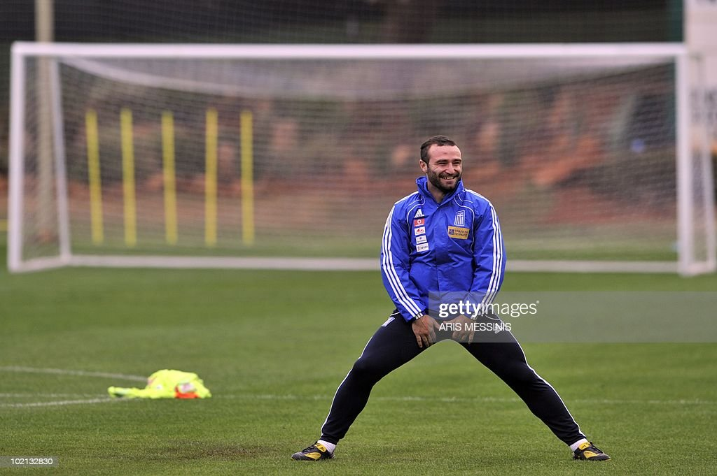 Greece's striker Dimitris Salpingidis stretches during a training session at the Northwood school in Durban on 15 June, 2010 during the 2010 World Cup football tournament in South Africa. AFP PHOTO / Aris Messinis