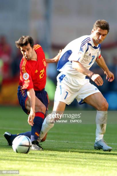 Greece's Theodoros Zagorakis and Spain's Juan Carlos Valeron battle for the ball